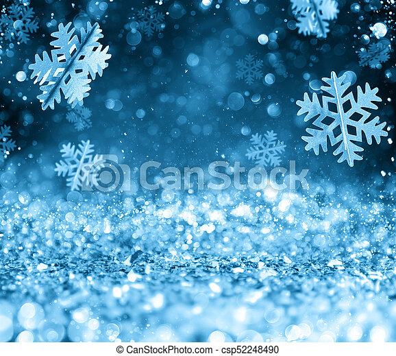 Abstract glowing Christmas blue background with snowflakes - csp52248490