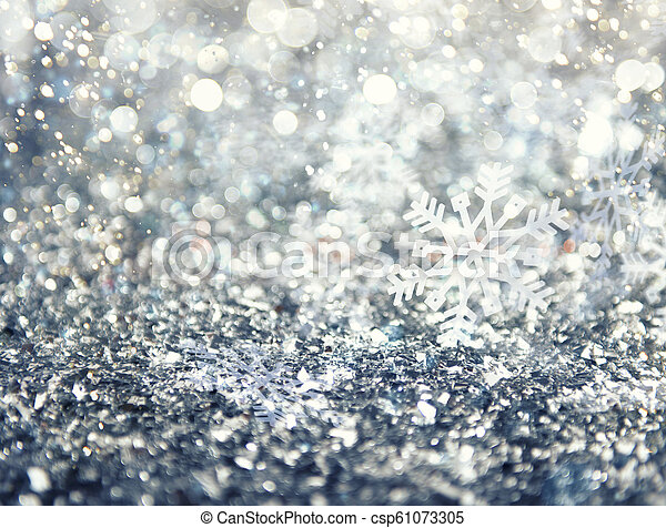 Abstract glowing Christmas blue background with snowflakes - csp61073305