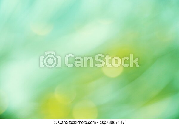 Abstract Green light bokeh background - csp73087117