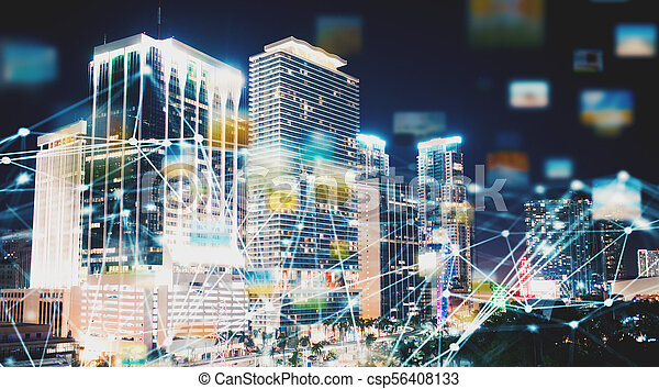 Abstract internet connection network with night city with skyscrapers at the background - csp56408133