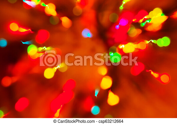 Abstract multicolored festive lights on a red and orange background. - csp63212664