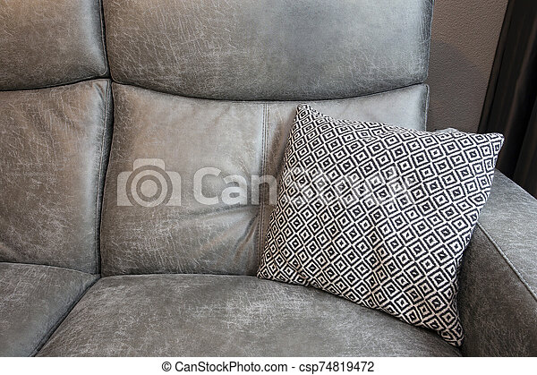 Abstract of Grey leather Sofa and black and white Pillows in modern living room background texture - csp74819472