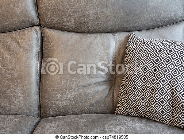 Abstract of Grey leather Sofa and black and white Pillows in modern living room background texture - csp74819505