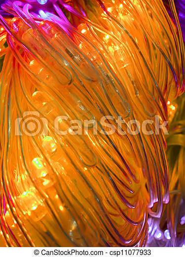 abstract yellow powerful illuminated tubes, power details - csp11077933