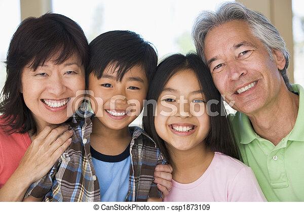 Abuelos posando con nietos - csp1873109