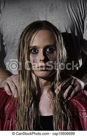 abused woman with man standing behi - csp15606699
