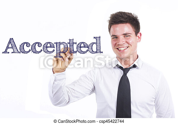 Accepted - Young smiling businessman writing on transparent surface - csp45422744