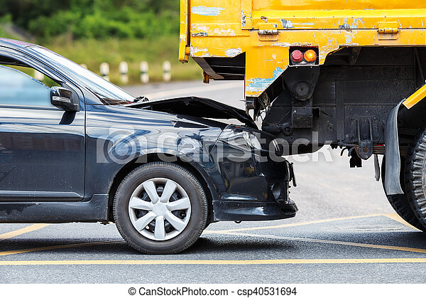 Accident on the road involving black car and yellow truck - csp40531694