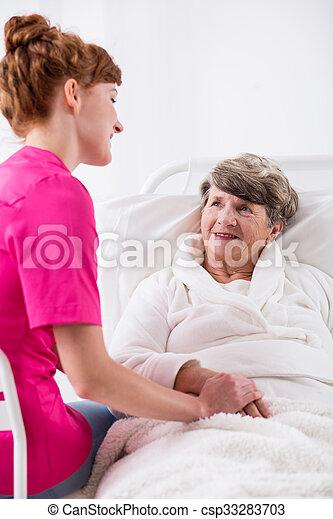 Accompanying elderly woman - csp33283703