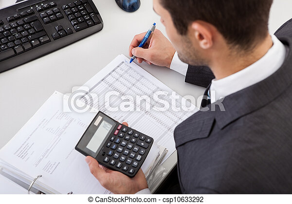 Accountant working at the office - csp10633292