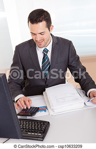Accountant working at the office - csp10633209