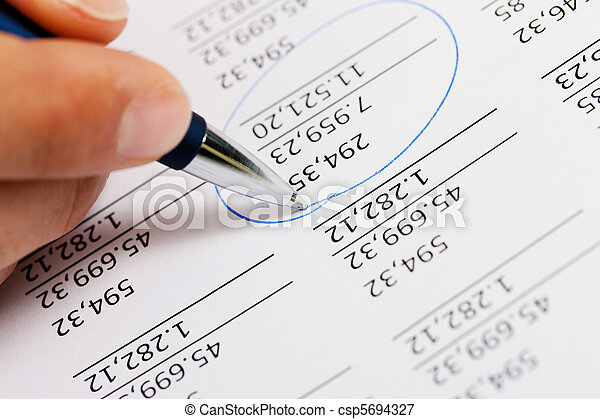 Accountant working on numbers - csp5694327