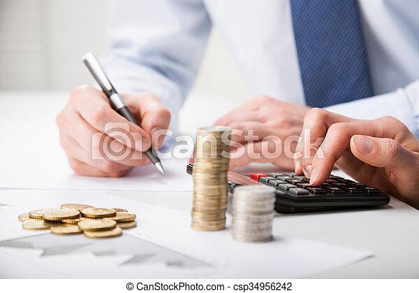 Accountants calculating profit - csp34956242