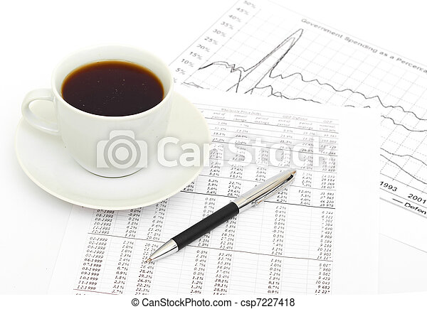 Accounting. Cup of coffee on document. - csp7227418