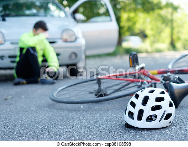 Aching man after bicycle accident on the asphalt - csp38108598