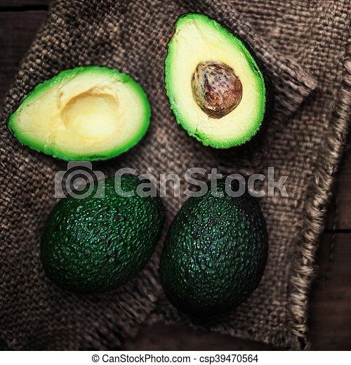 achtergrond, halved, rustiek, op, geheel, avocado - csp39470564