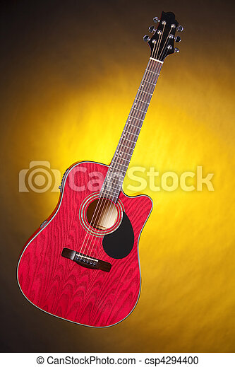Acoustic Guitar Isolated On Yellow