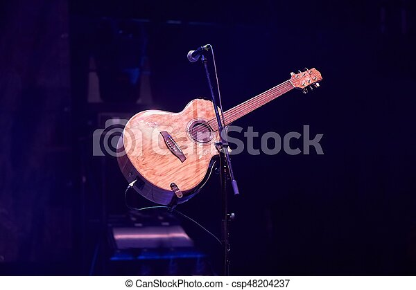 Acoustic Guitar On Stage Acoustic Guitar On Stand On A Stage
