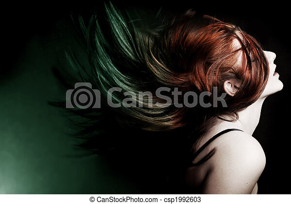 Action shot of an attractive model swinging her hair. - csp1992603