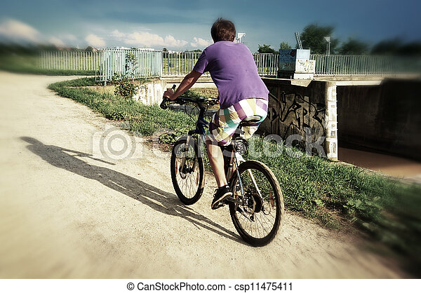 Active bicyclist riding - csp11475411