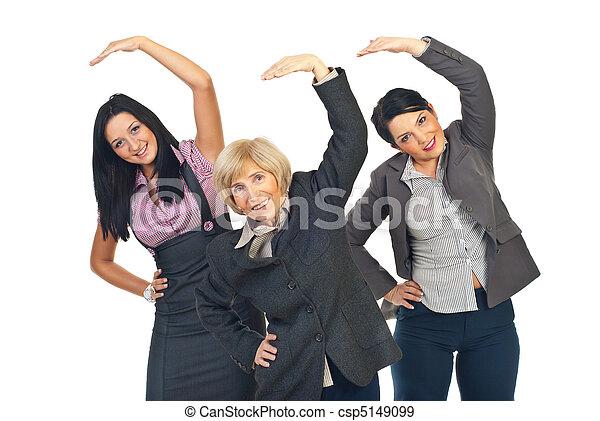 Active businesswomen stretching hands - csp5149099