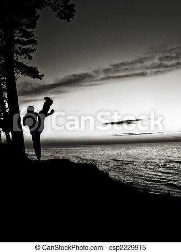 Active man training martial arts near the beach - csp2229915
