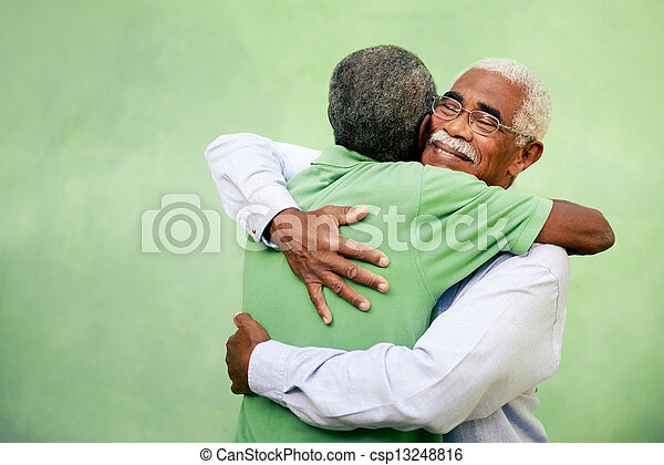 Active retired old men and leisure, two senior black brothers hugging outdoors - csp13248816