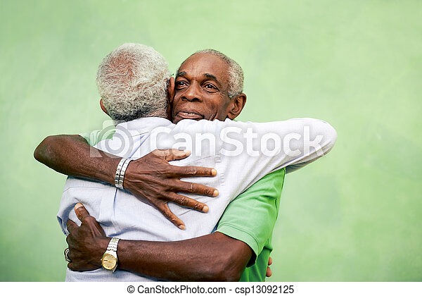 Active retired old men and leisure, two senior black brothers hugging outdoors - csp13092125