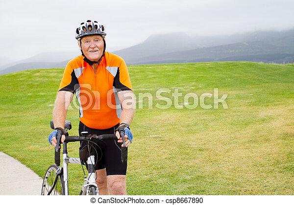active senior male bicyclist portrait - csp8667890