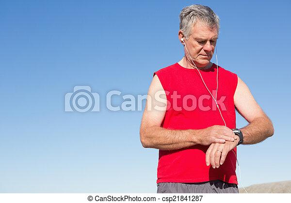 Active senior man jogging on the pier - csp21841287