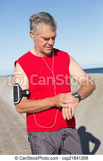 Active senior man jogging on the pier - csp21841268