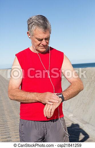 Active senior man jogging on the pier - csp21841259