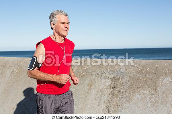 Active senior man jogging on the pier - csp21841290