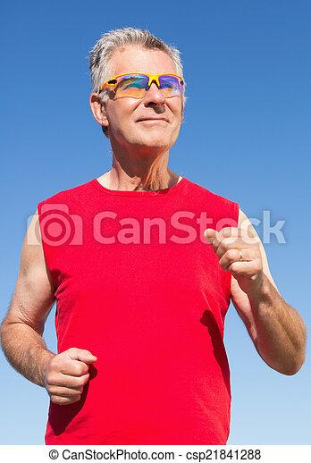 Active senior man jogging - csp21841288