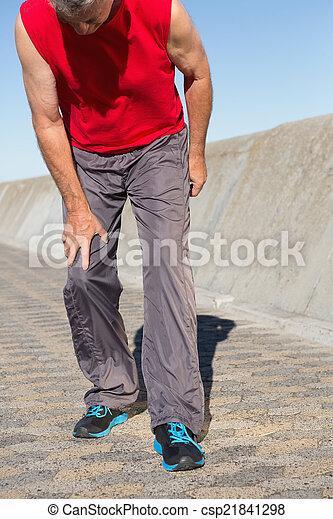 Active senior man touching - csp21841298