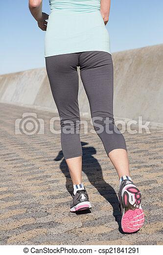 Active senior woman jogging on the pier - csp21841291