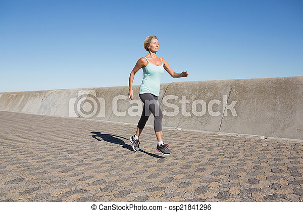Active senior woman jogging on the pier - csp21841296