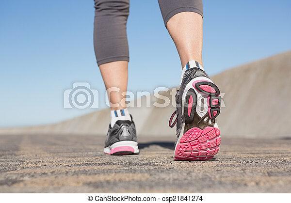 Active senior woman jogging  - csp21841274