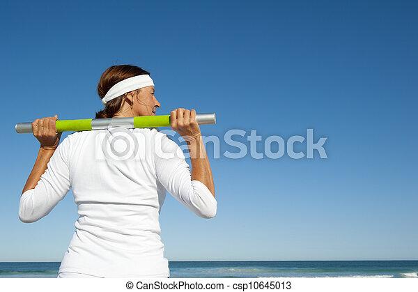 Active senior woman ocean background - csp10645013