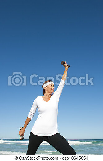 Active senior woman ocean background - csp10645054