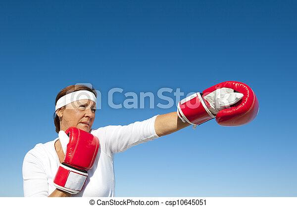Active senior woman sky background - csp10645051