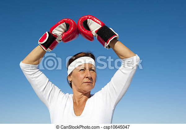 Active senior woman sky background - csp10645047