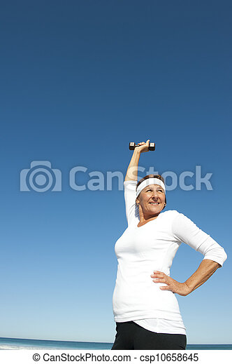 Active senior woman sky background - csp10658645