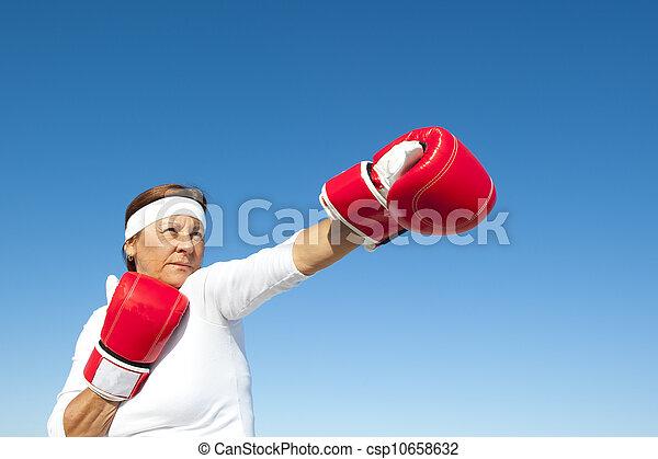 Active senior woman sky background - csp10658632