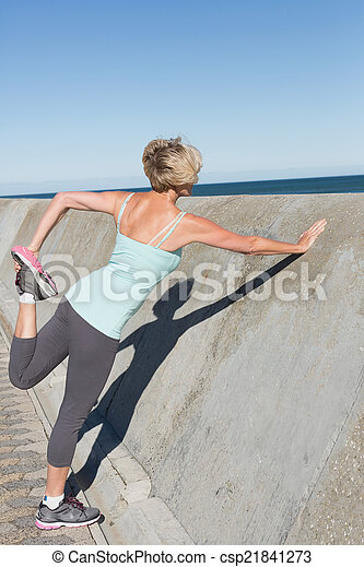 Active senior woman stretching on the pier - csp21841273