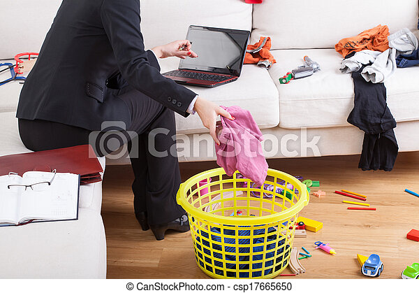 Active woman cleaning house and working - csp17665650