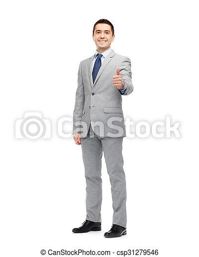 Un feliz hombre de negocios con traje mostrando pulgares arriba - csp31279546