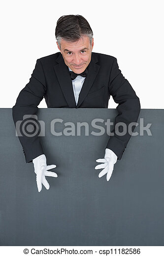 Camarero mostrando la tabla gris - csp11182586