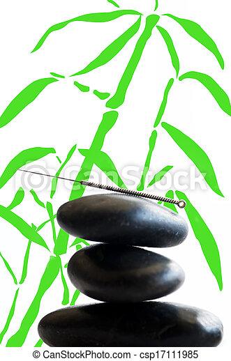 acupuncture needle on stone pyramid - csp17111985
