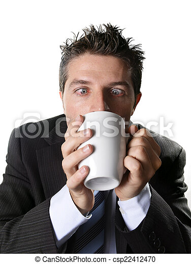 addict business man in suit and tie drinking cup of coffee anxious and crazy in caffeine addiction - csp22412470